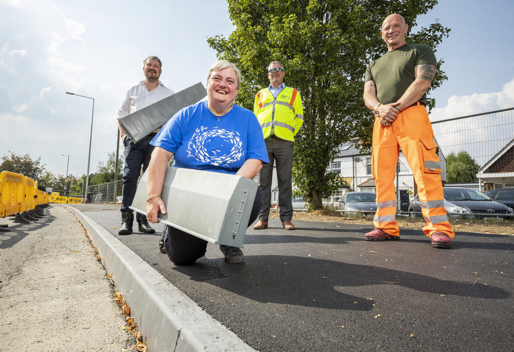 council officers and elected members demonstrating plastic kerbing