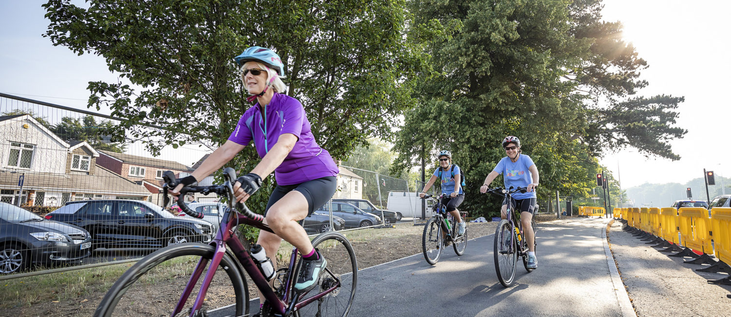 Three people cycling on a cycle path