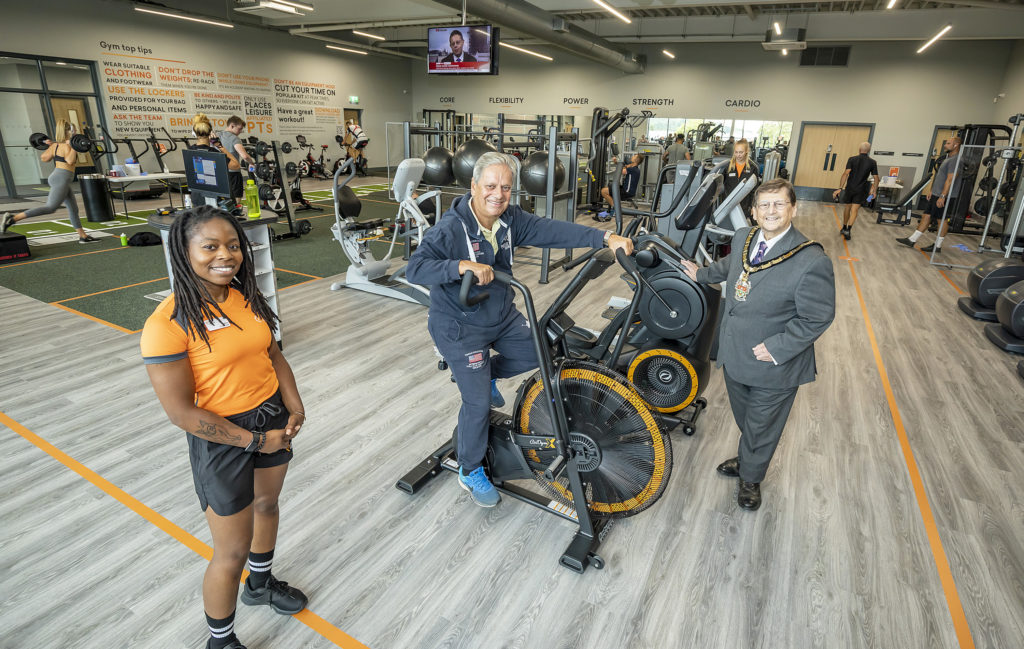 Wokingham Borough Councillor Parry Batth tries an exercise bike in the new Bulmershe gym