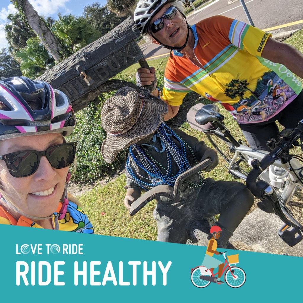 three peopole riding bikes