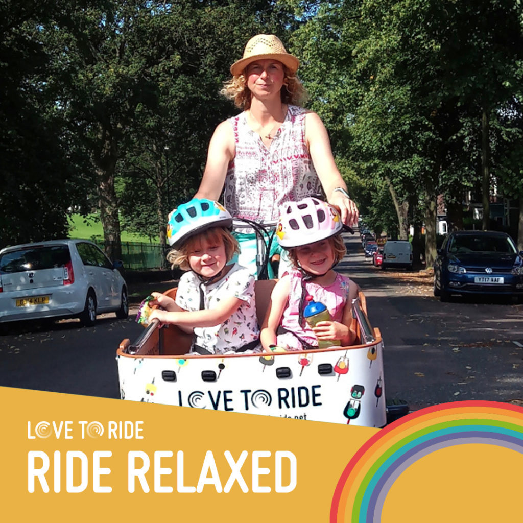 two children and a woman on a bike