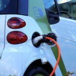 an electric vehicle being charged