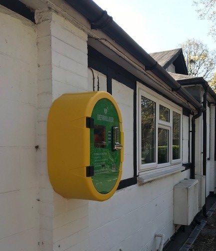 a defibrillator box on an external wall