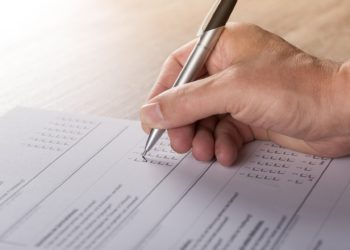 A paper survey being completed